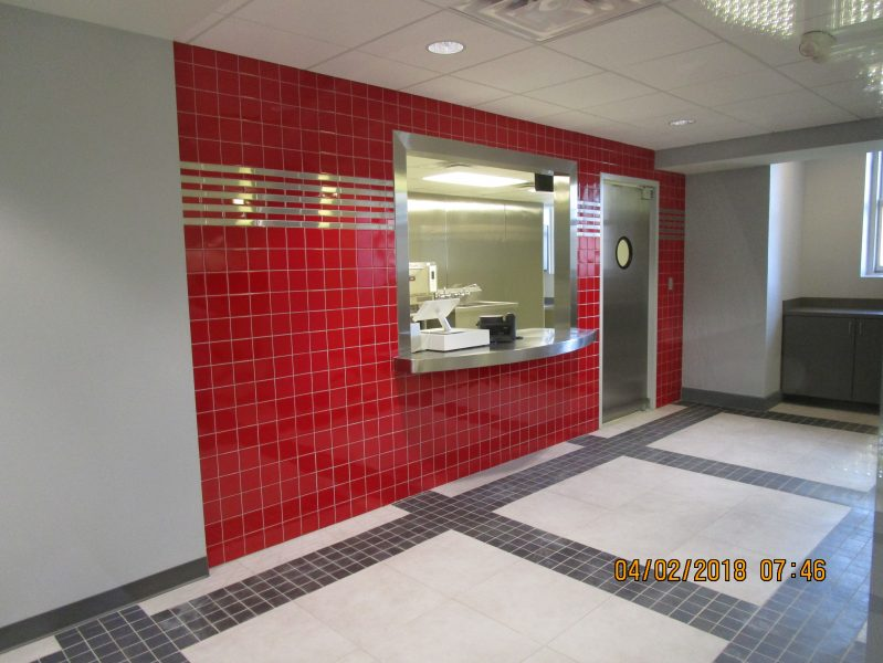 OPCC Snack Bar. Porcelain Floor tille over Schluter Ditra underlayment, and Ceramic Wall Tile with stainless steel accents